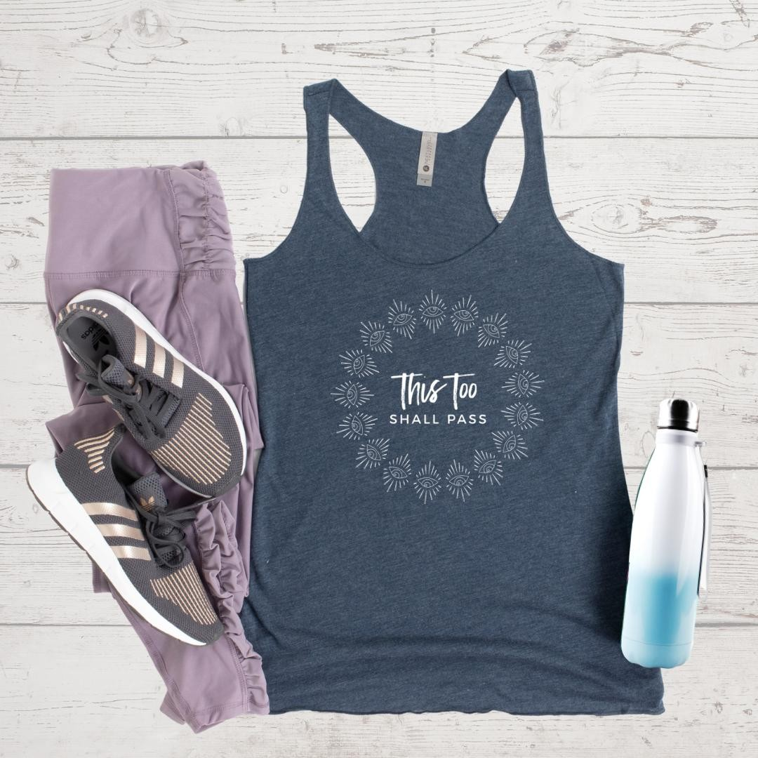 Who else wishes these trying times would just pass already?! 🏽‍♀️ ⁠⁠Our shop is still open if you could use an inspiring message for yourself or for a friend during this difficult year.⁠⁠Tanks come in Indigo (pictured), Envy, and Vintage Purple tri-blend... and are perfect for working out or lounging.⁠⁠Please note, there's a shipping delay at our warehouse because of safety and staffing due to covid.⁠⁠5% of net proceeds goes to @mentalhealthamerica. Link to shop is in my bio.⁠⁠⁠⁠⁠⁠⁠⁠⁠⁠#ichoosebeauty #thistooshallpass #covid2020 #lifeinthetimeofcorona #wearabletherapy #wearableart #wordsofencouragement⁣⁠ #tanktops #athleisurewear #athleisurestyle #yogaclothes #yogastyle #workoutclothes #workoutinstyle #workoutapparel #workoutgear #workoutwear #giftsforfriends #perfectgifts #mentalhealthsupport #mentalhealthisimportant⁠⁠