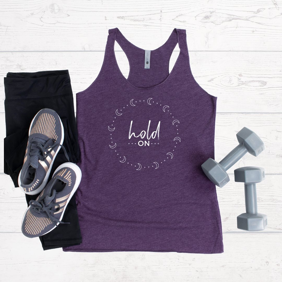 If you're hurting and don't think you can take anymore, hold on. You will get through this pain, even if it doesn't seem like it right now.⁣⁠⁣Tanks come in Vintage Purple (pictured), Envy, and Indigo tri-blend... and are perfect for working out or working out, running errands, or lounging.⁣⁠⁣5% of net proceeds goes to @mentalhealthamerica. Tap to shop.