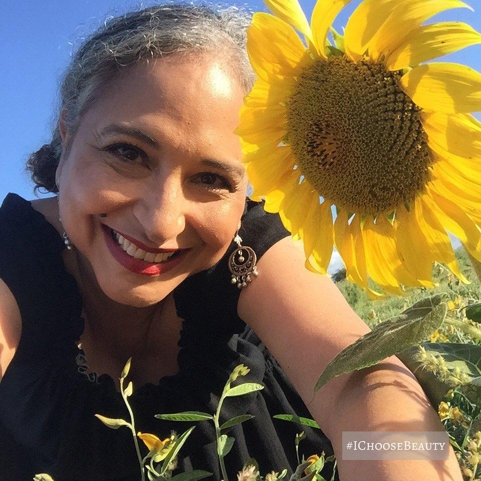 When a girl from the sunflower state meets a sunflower.    #kansasgirl #ichoosebeauty Day 2691