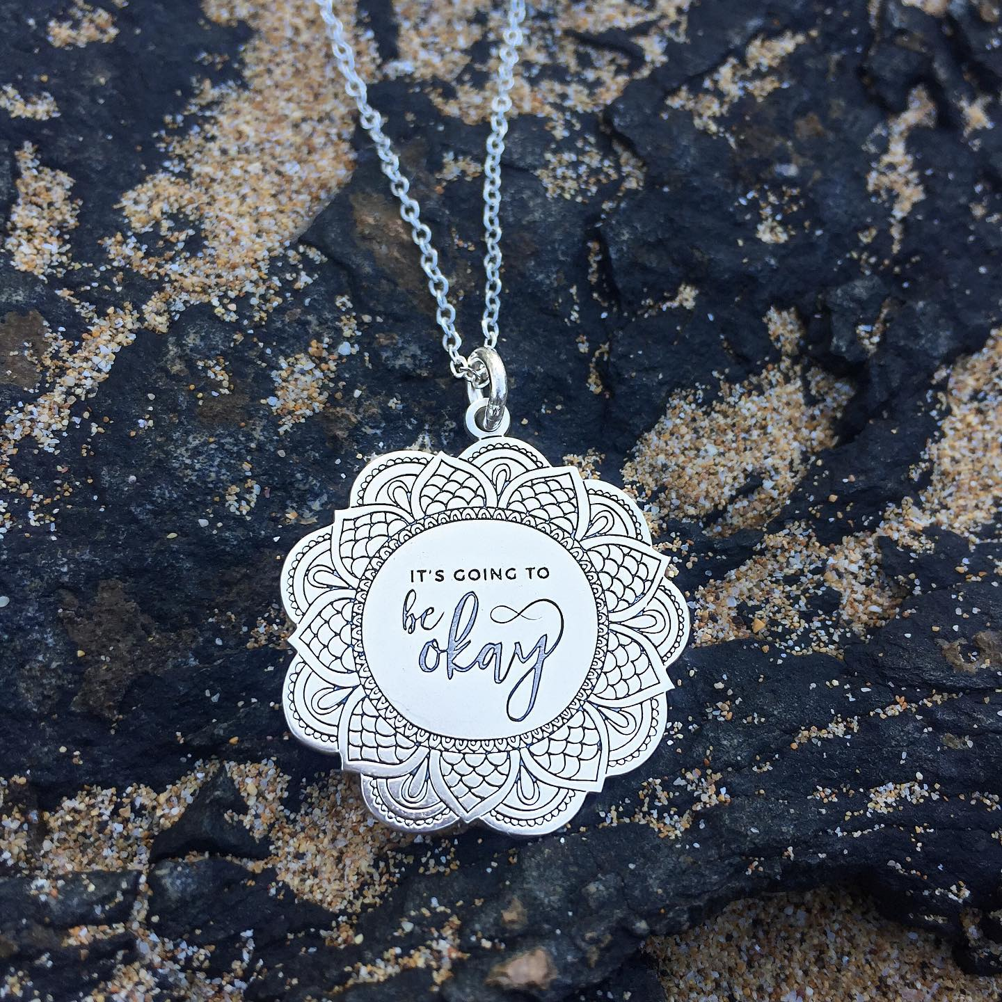 Say it out loud to yourself. Say it even if you don't believe it. It will comfort you and help you get through the awful times until things really are okay.All of our custom-engraved sterling pendants are created using the healing power of words, and double as a grounding tool. I'm constantly holding on to mine when I wear it. 5% of net proceeds goes to @mentalhealthamerica. 