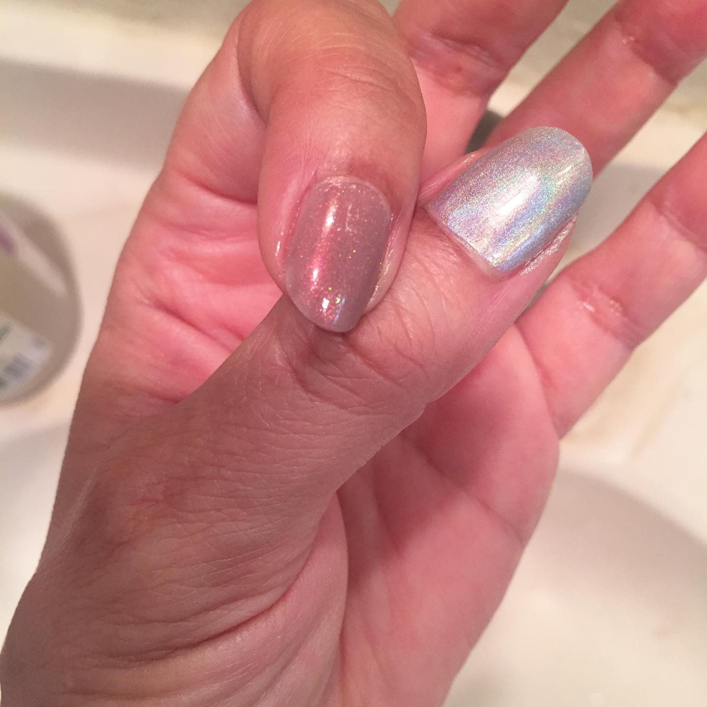 Trying to decide which shiny color to use. The one on my thumb or the one on my index finger? Help. 😀#ichoosebeauty Day 2854