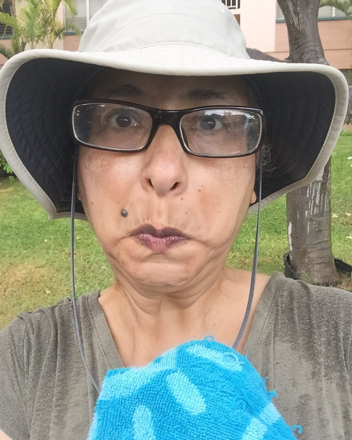 """The face you make when you get drenched going on """"just a quick walk"""" on the beach during a break in the rain. 😬🤣🤣 I'm happy to report though that my sun hat apparently doubles as a rain hat. #ichoosebeauty Day 2856"""