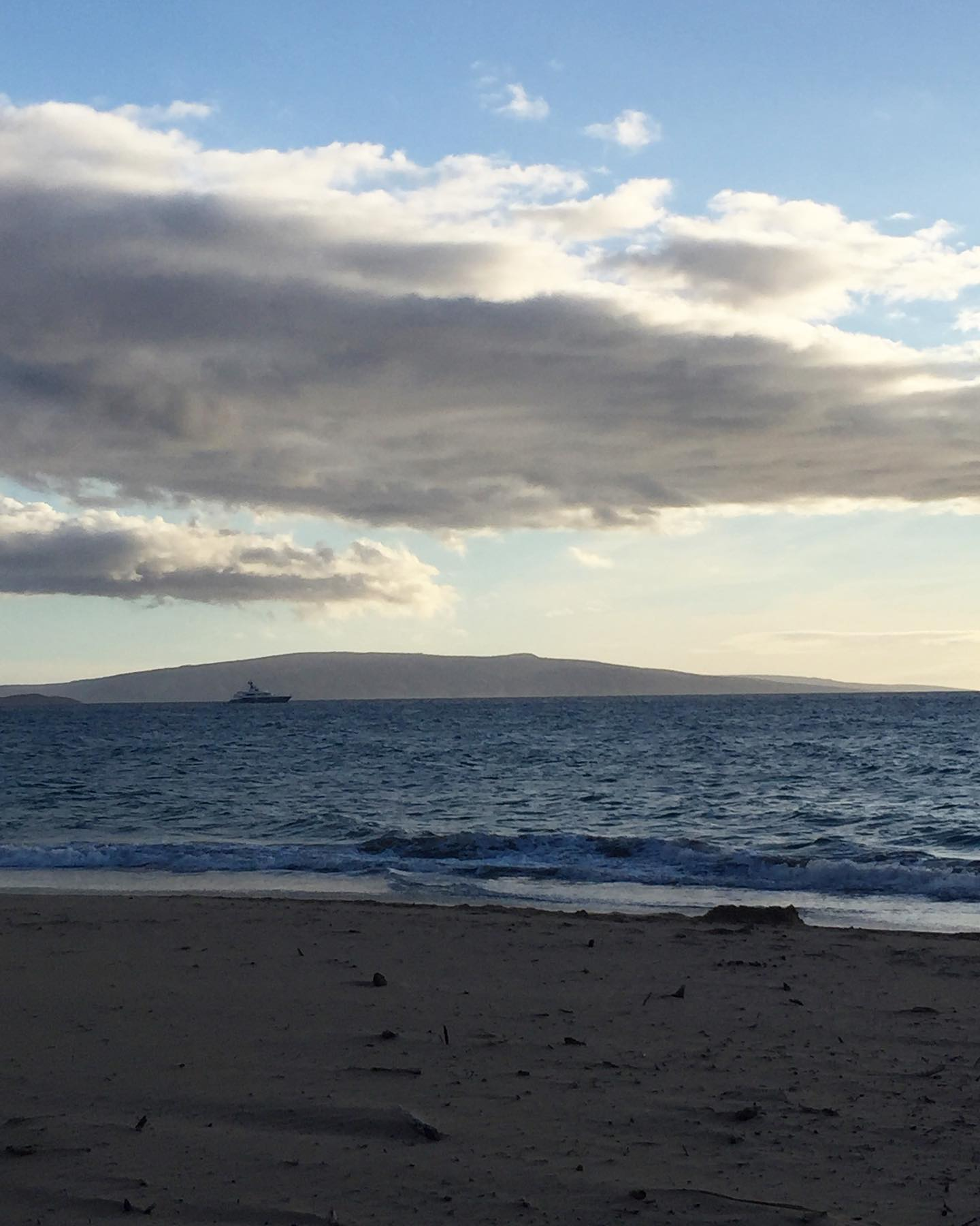 Sky, clouds, sky, island in the distance, ocean, sand. So many layers in this shot, kind of like those artsy sand layers in a bottle. #ichoosebeauty Day 2879